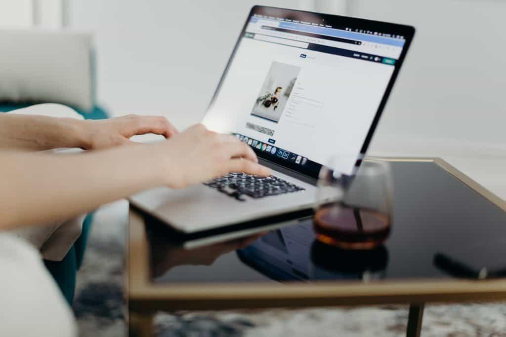 person using macbook laptop 3584969