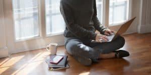 woman in gray sweat shirt sitting beside window 3759080