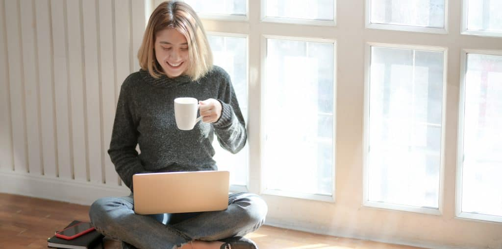 woman in gray sweater drinking coffee 3759089